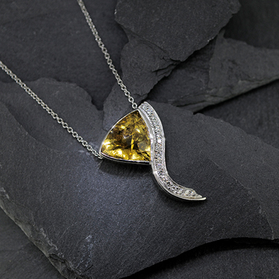 A silver Necklace with large yellow jewel